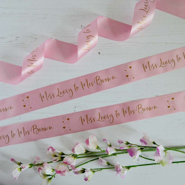 48mm pastel pink personalised hen party ribbon with matt antique gold print